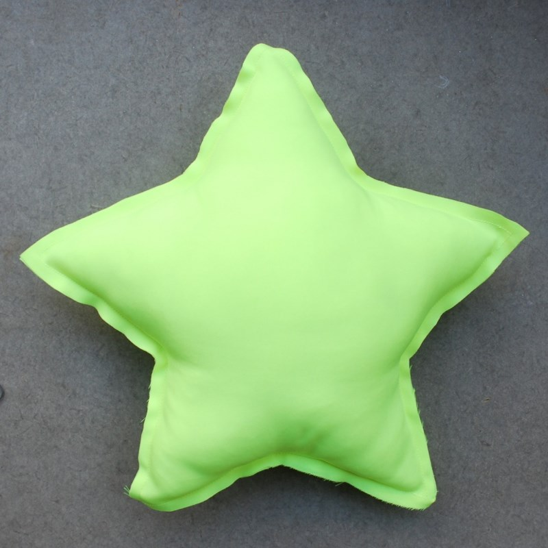 Fluorescent yellow star pillow