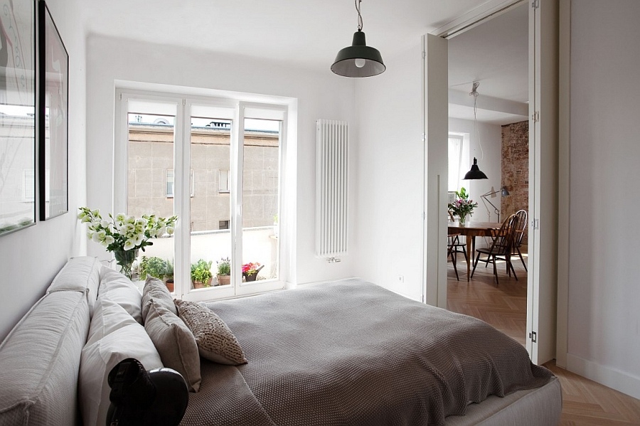 Folding doors and elegant use of glass doors gives the bedroom an airy appeal