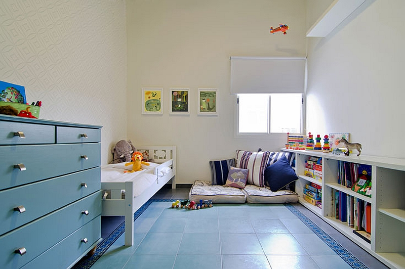 Geometric wallpaper in the nursery with gray and turquoise tiles