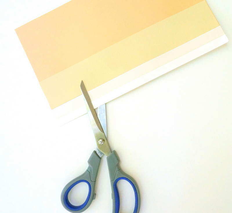 Glue strips of paper to a background page, then cut the shape of your choice