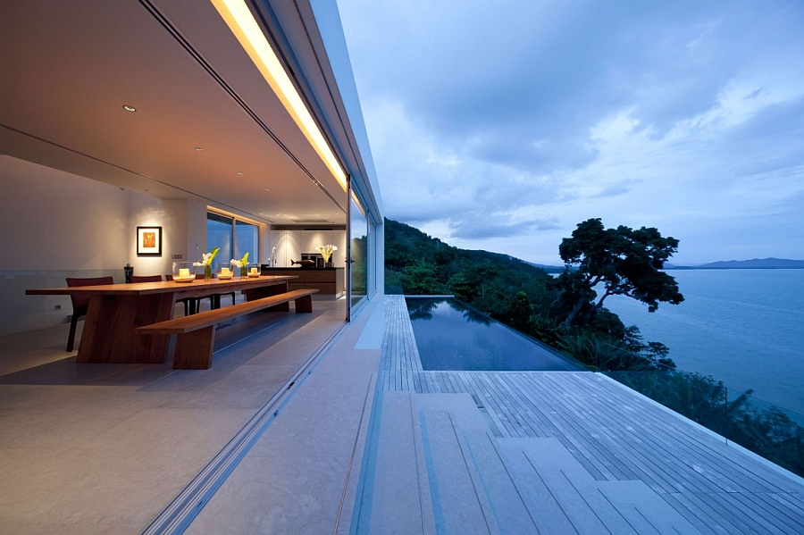 Gorgeous outdoor deck with infinity pool and transparent railing