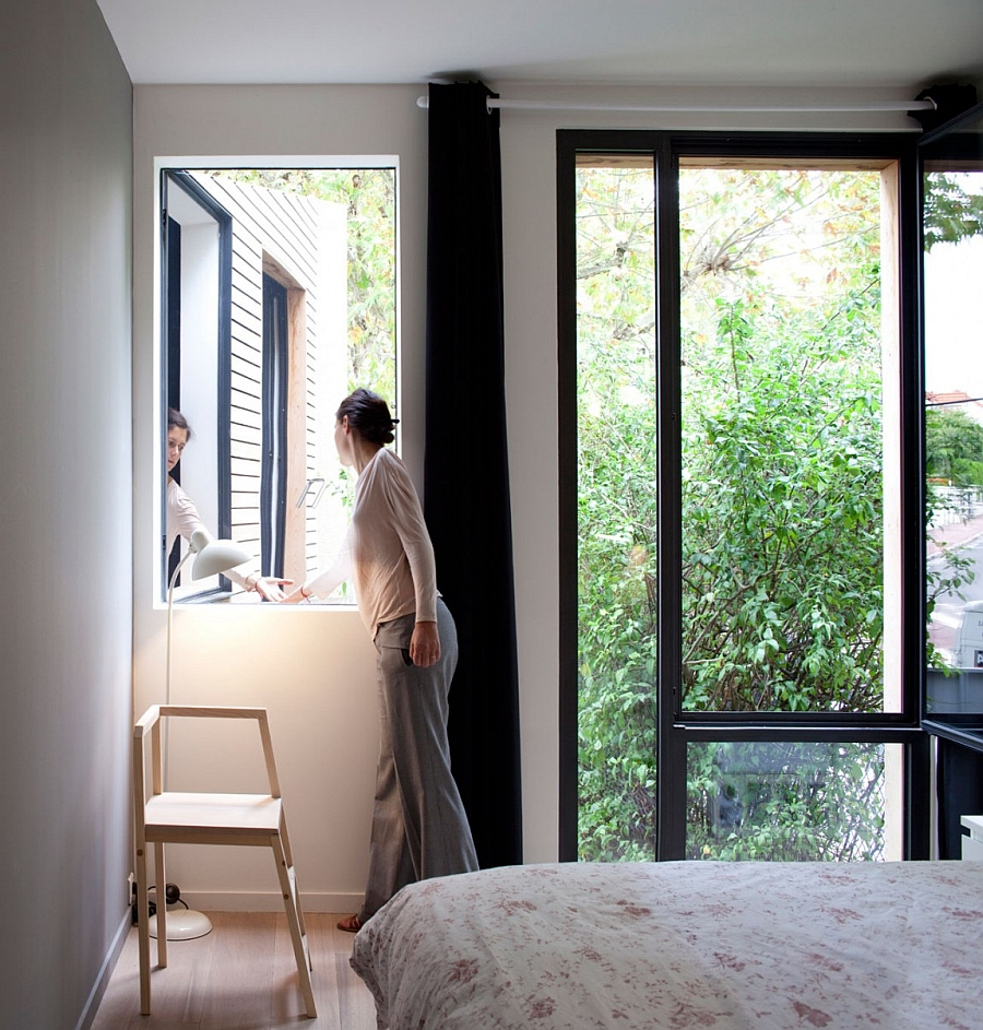 Greenery outside becomes a natural part of the bedroom