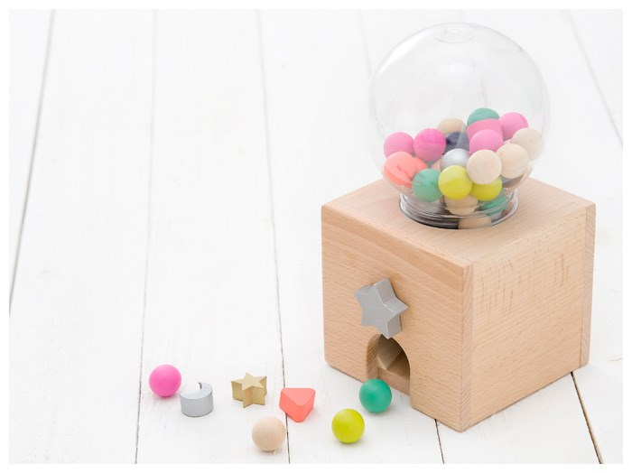 Gumball machine with wooden pieces