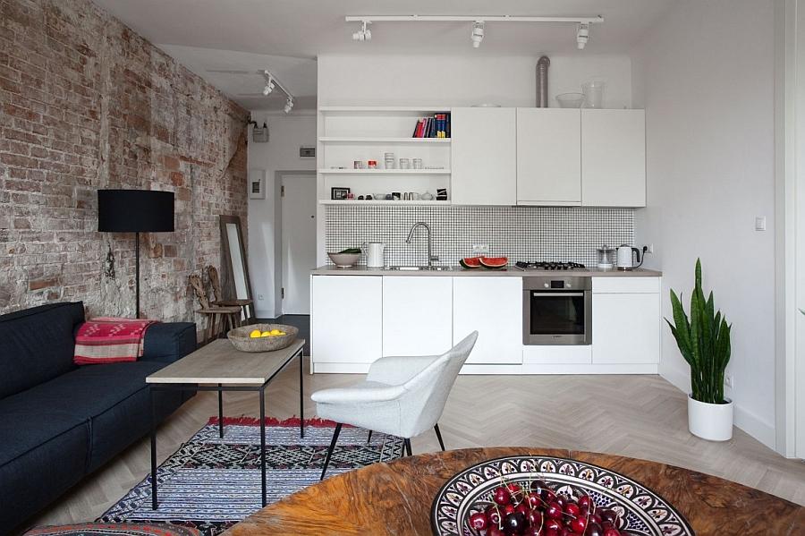 Herringbone pattern on the floor and kitchen backsplash add style to the interior