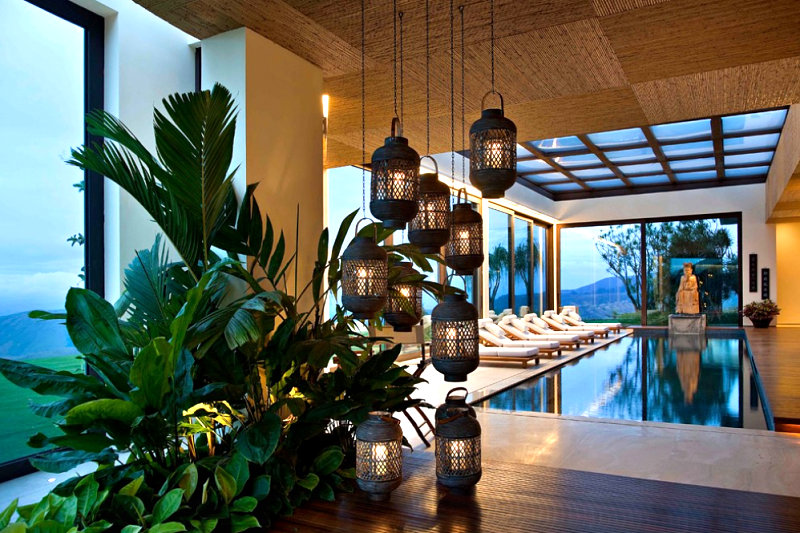 Indoor pool with lanterns and greenery