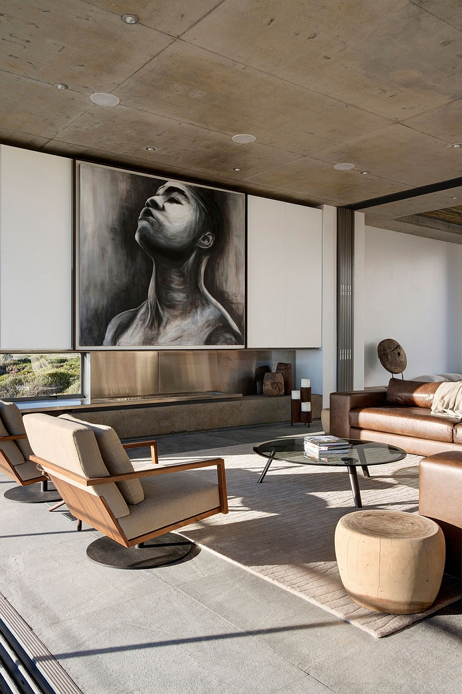 Large painting above the fireplace complements the neutral color scheme of the interior