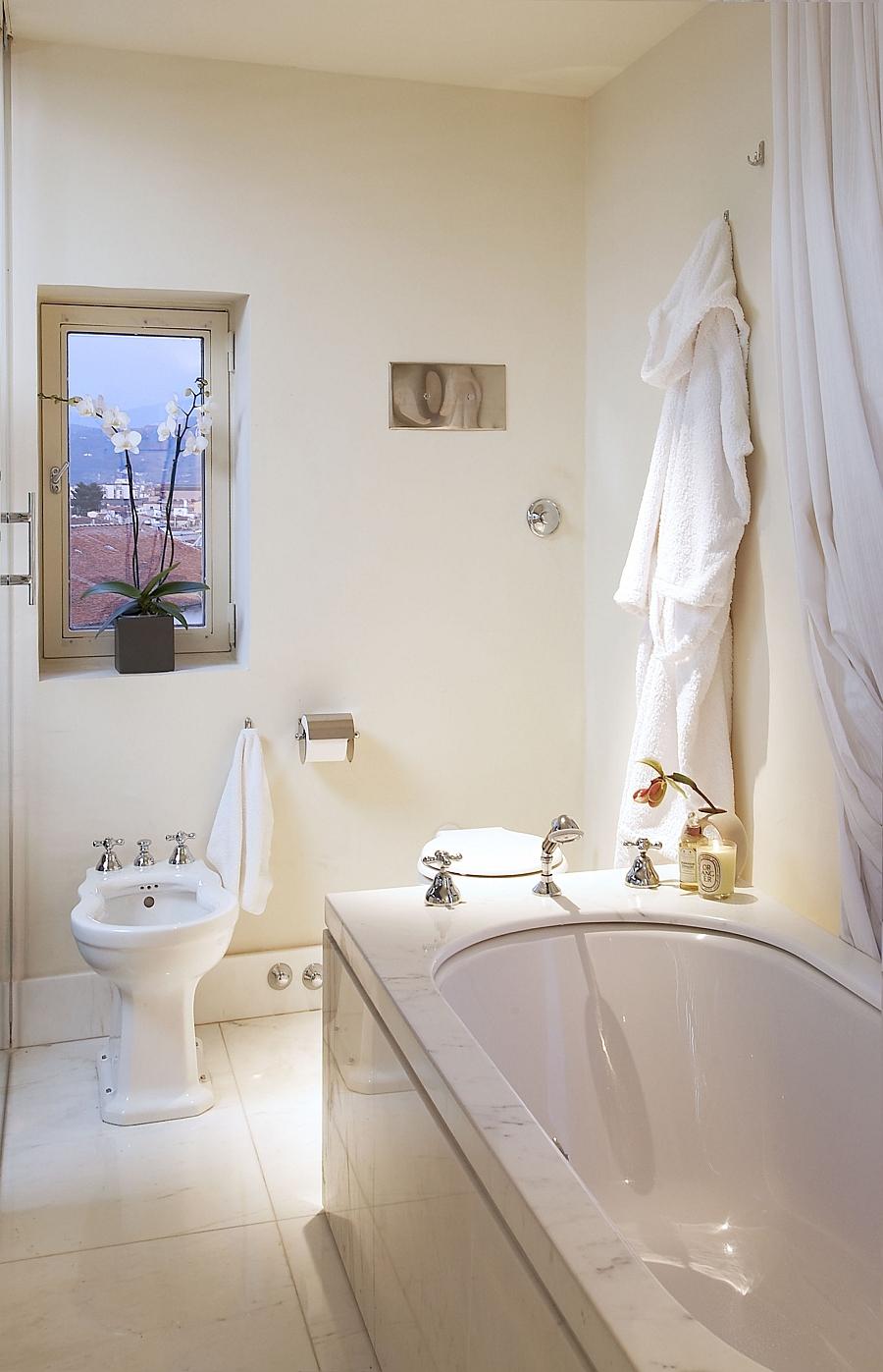 Lavish bathroom has an organic and serene appeal
