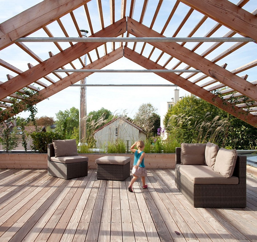 Lovely pergola looks like an unfinished roof as it houses a green vegetable and fruit garden