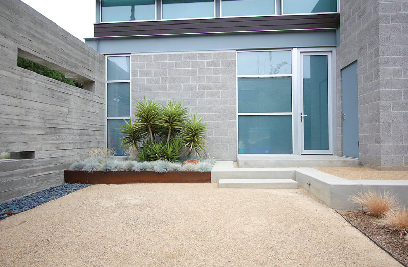 Manicured outdoor space with gravel and pathways