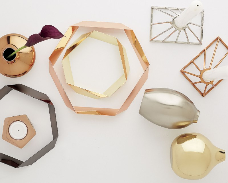 Metal candleholders, vases and trivets from CB2