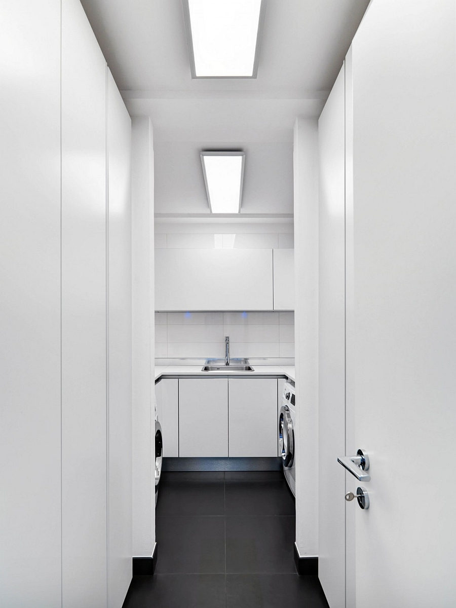 Minimal and space-conscious laundry room in white