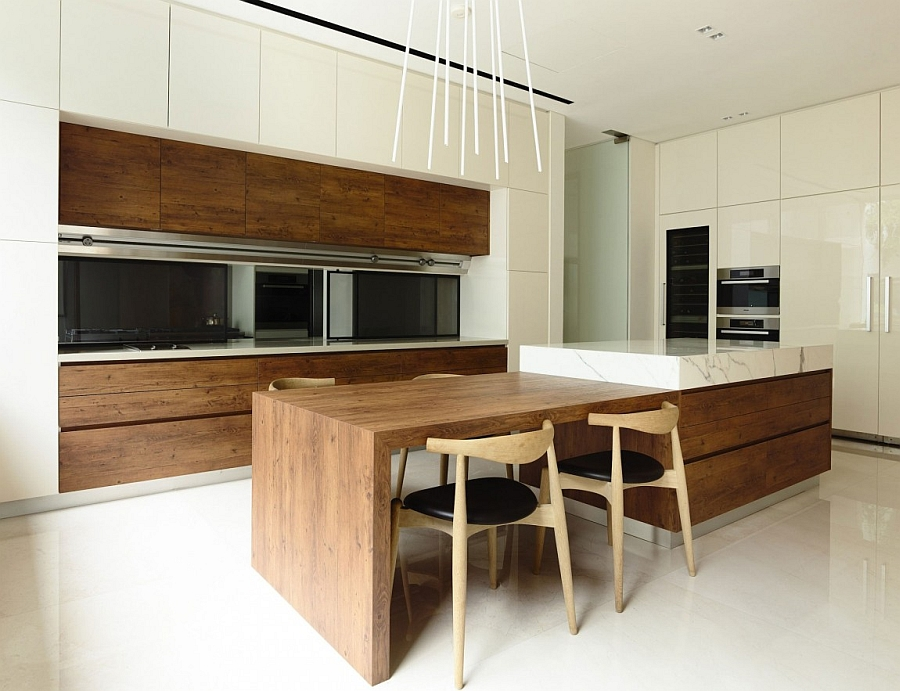 Minimal modern kitchen and dining area with warmth of natural wood