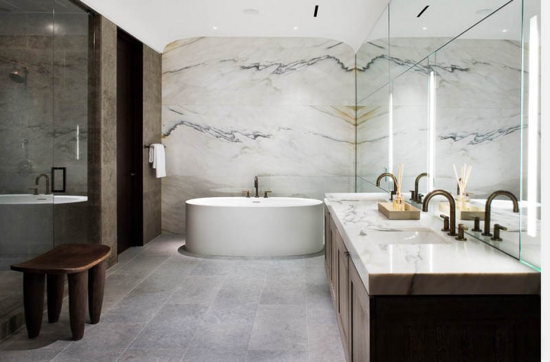 Modern bathroom with marble walls and countertop