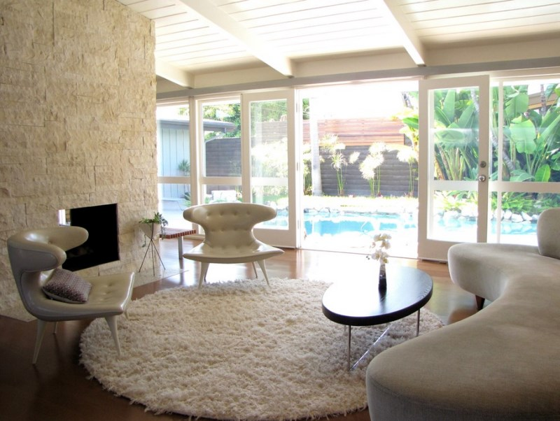 Modern living room with a pool view