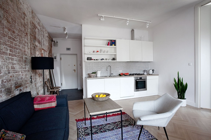 Open plan living area and kitchen in the small Warsaw apartment Small Private Apartment In Warsaw Gets A Bright And Cheerful Makeover