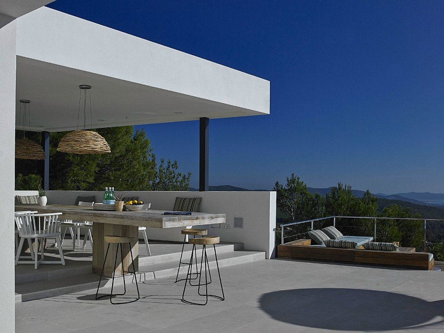Outdoor dining area and lounge with a view of the distant mountains