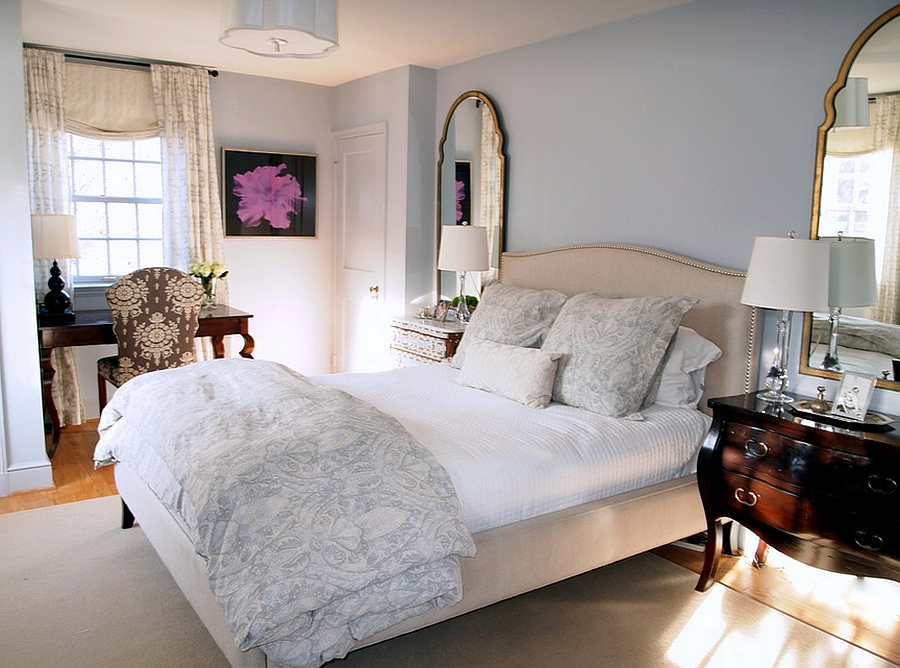 Pale grey and blue give the bedroom a serene backdrop [Design: Elizabeth Reich]