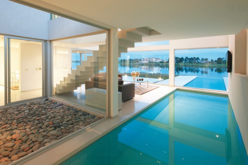 Pool house with a lagoon view