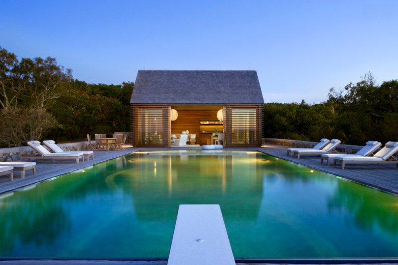 Pool house with a tranquil view