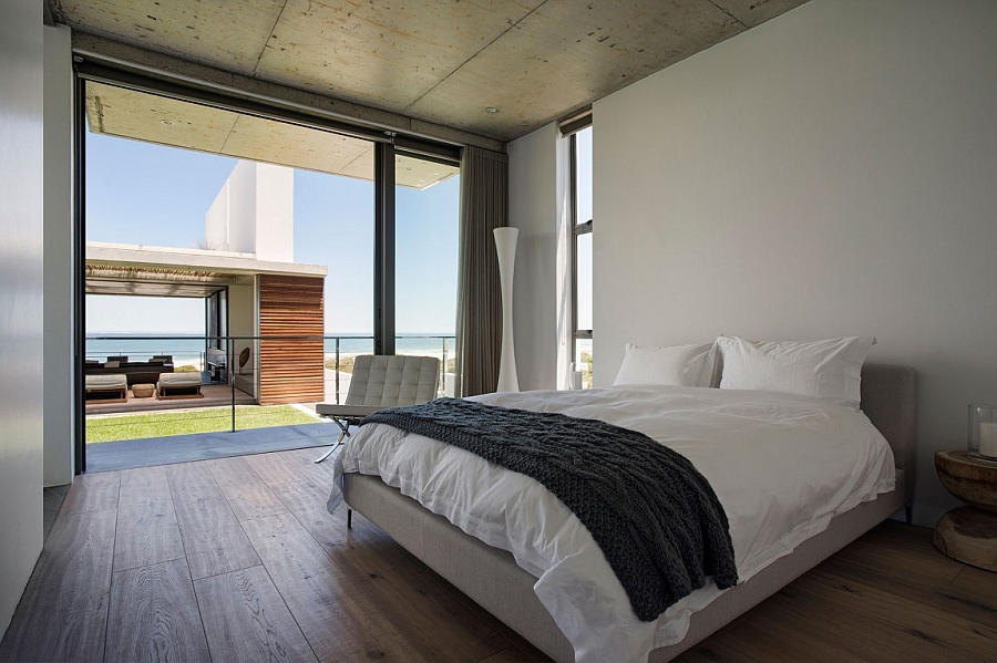 Serene bedroom overlooks the living area and the distant ocean