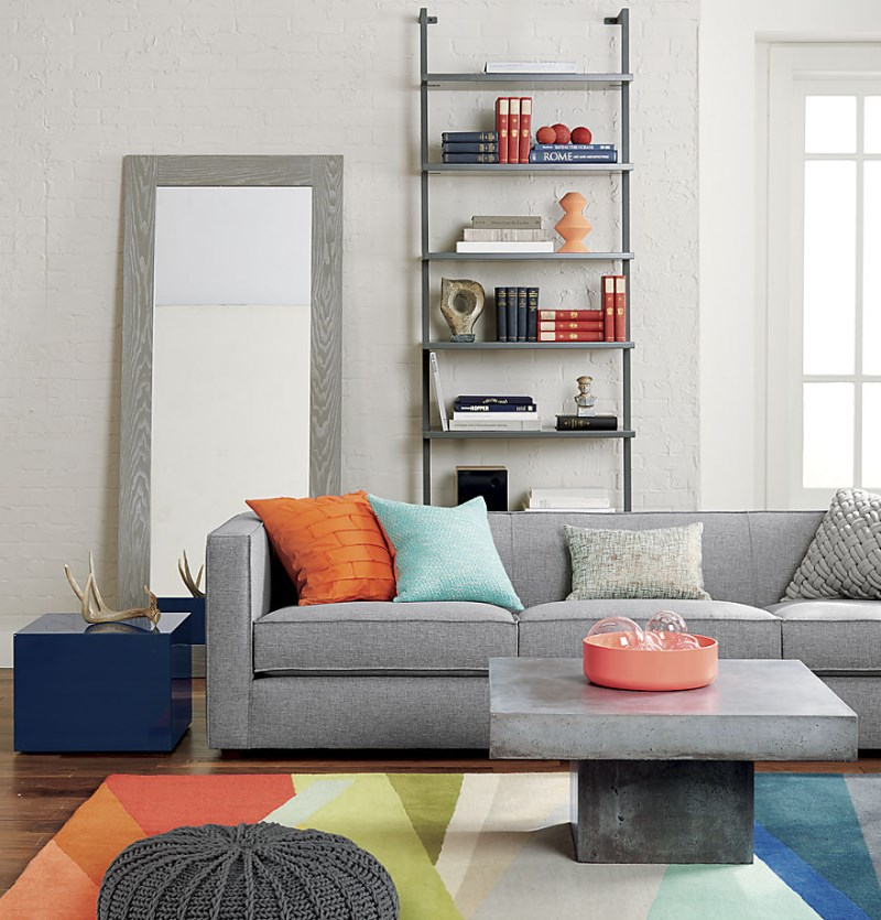 Shades of orange and peach in a gray living room