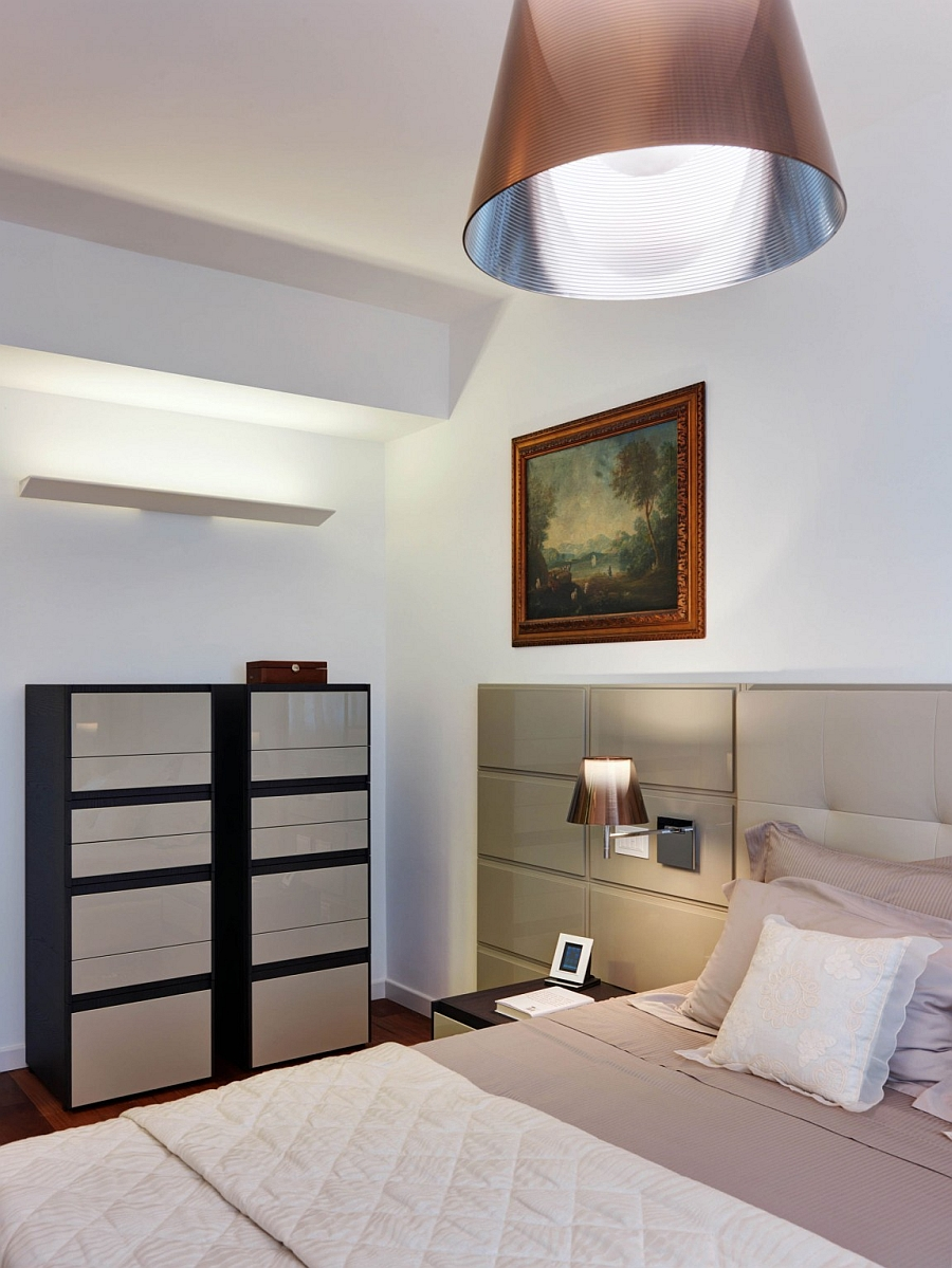Sleek Italian decor and elegant lighting in the bedroom