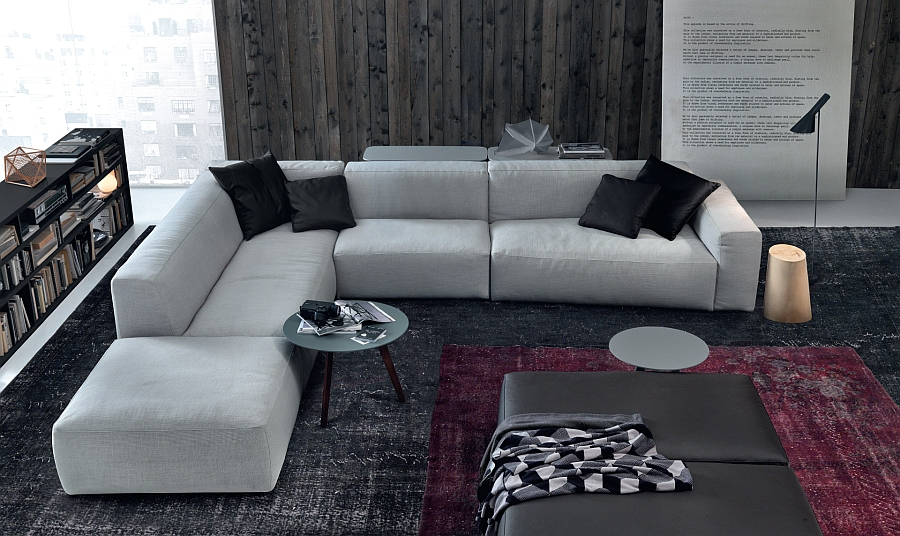 Sleek and curvy coffee tables complement the low-slung appeal of the couch