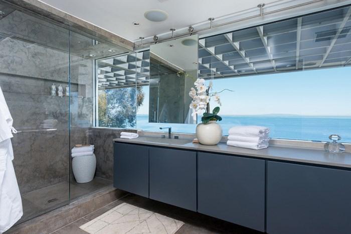 Sleek bathroom with an ocean view
