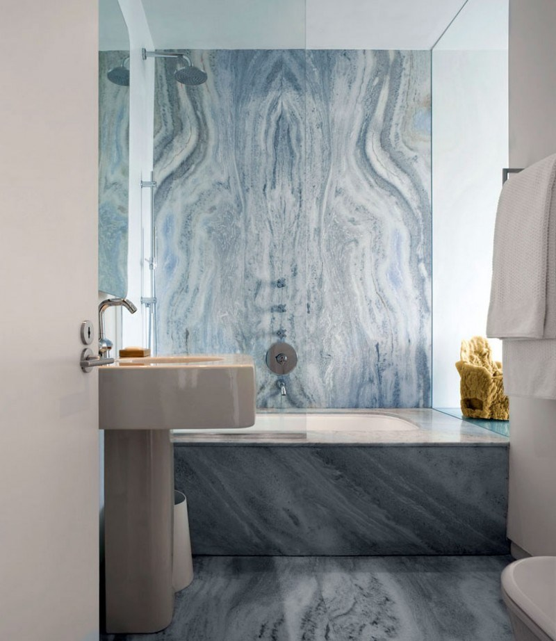 Sleek bathroom with blue-toned marble