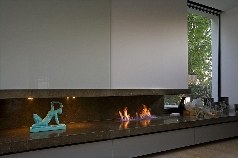 Sleek contemporary fireplace and curated decor in the London home