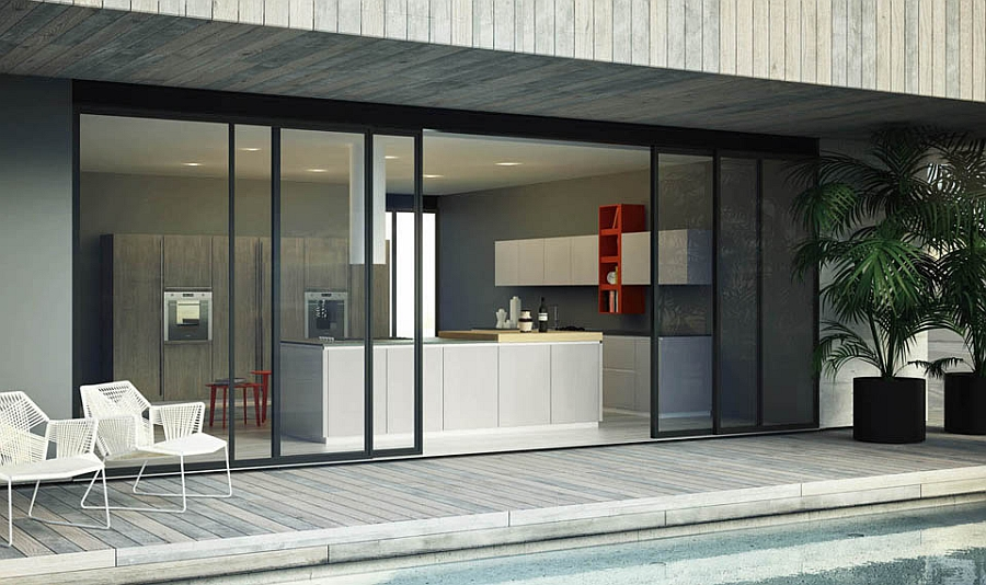 Sliding glass doors connect the kitchen with the deck outside