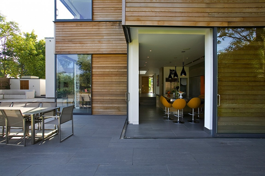 Exclusive contemporary london home blends urbane style for Corner sliding glass doors