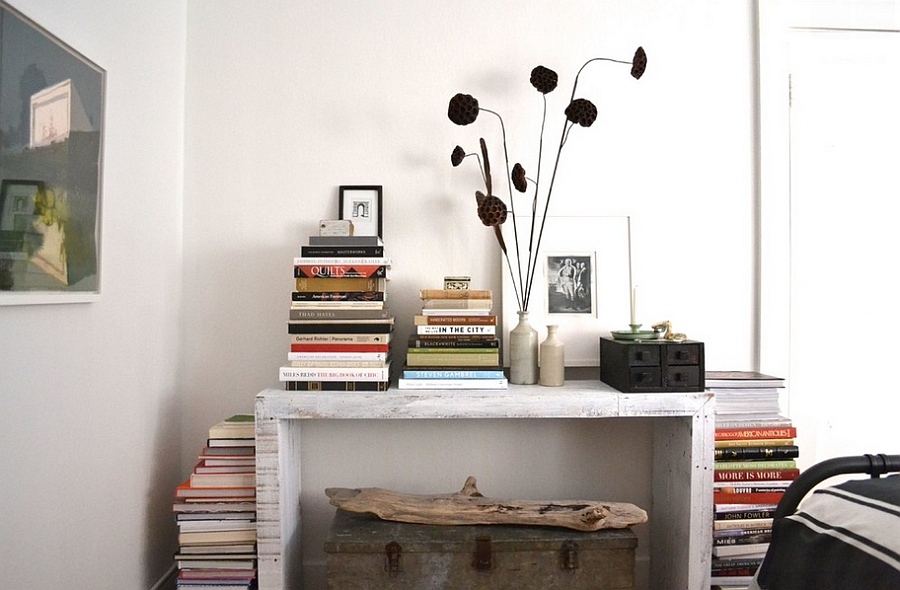 Stacking the books in style also saves up space! [Design: Brian Paquette Interiors]