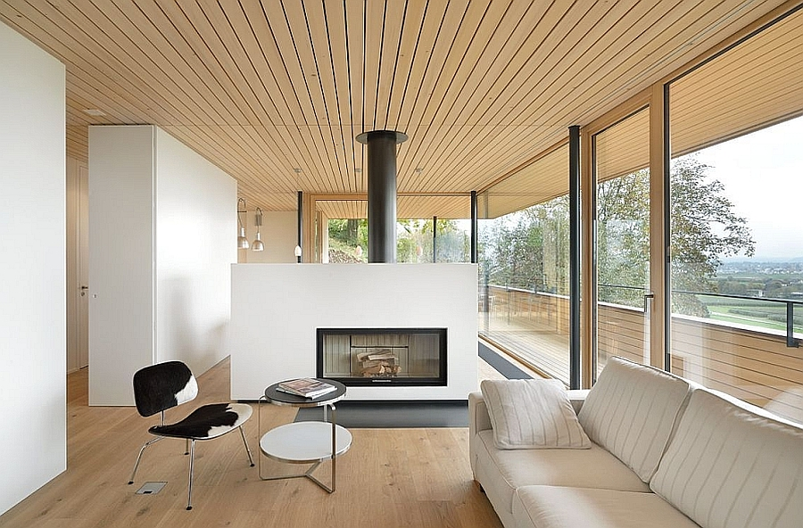 Stove in the living room acts as a divider between the living space and the dining