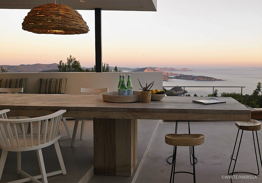 Stunning deck space and outdoor dining area with with a view of the distant sea