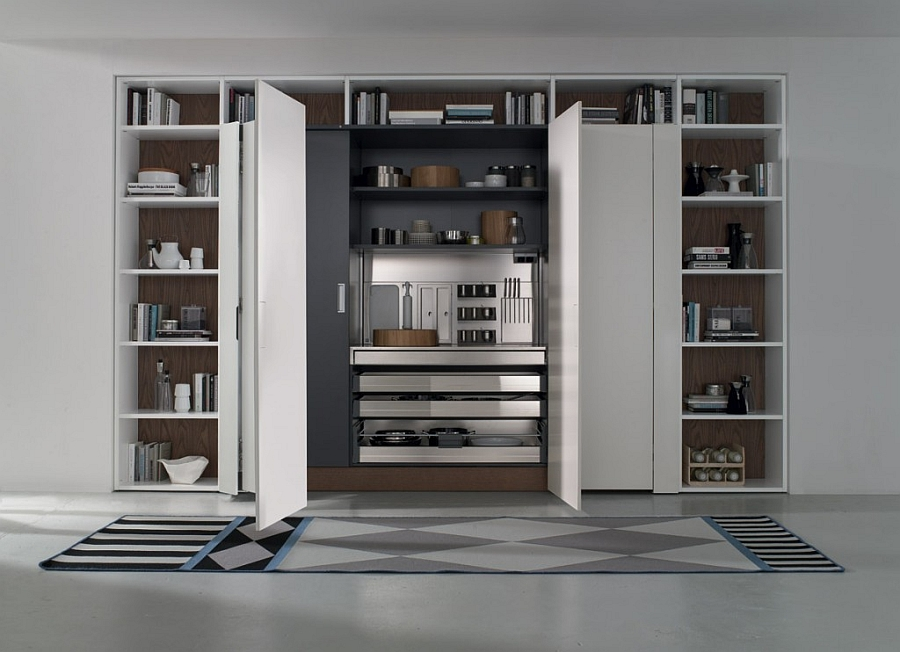 Tall kitchen unit with pocket doors combines form with function