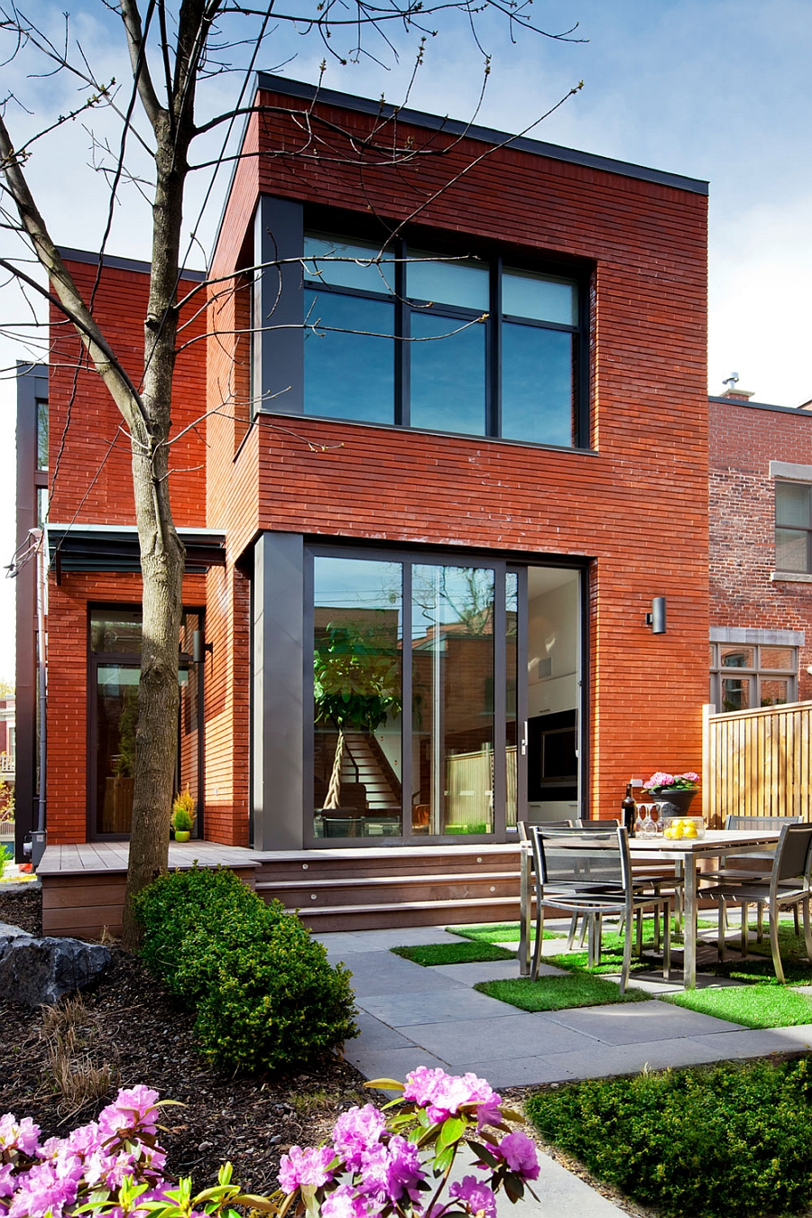 Unique Exterior of the house blends with the surrounding homes in the historic neighborhood Ingenious Montreal Residence Blends Heritage Appeal With Modern Flair