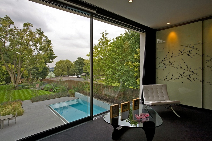 View of the pool area and the backyard from the bedroom