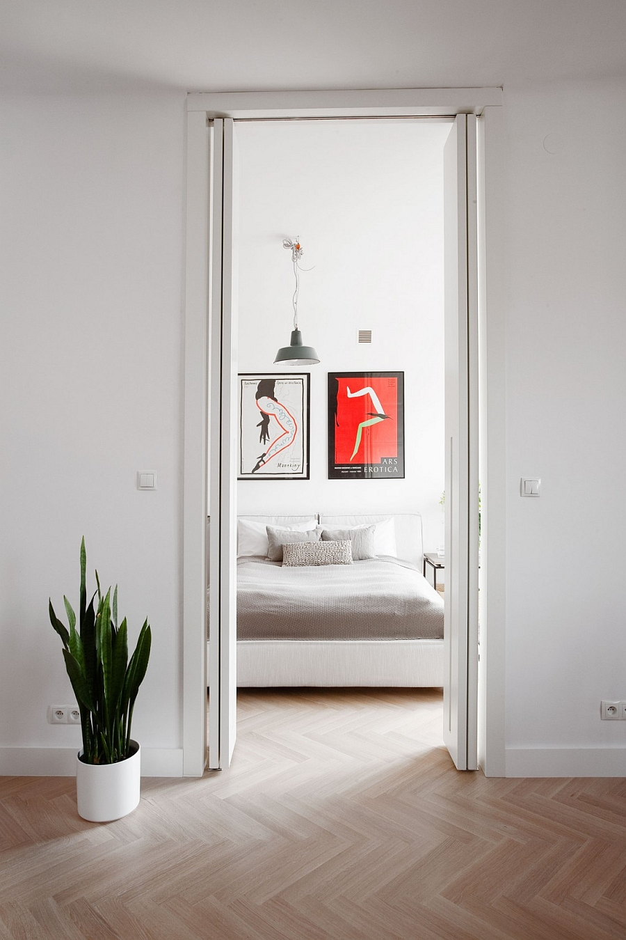 Vinatge Posters from the 70s and 80s add color to the contemporary bedroom