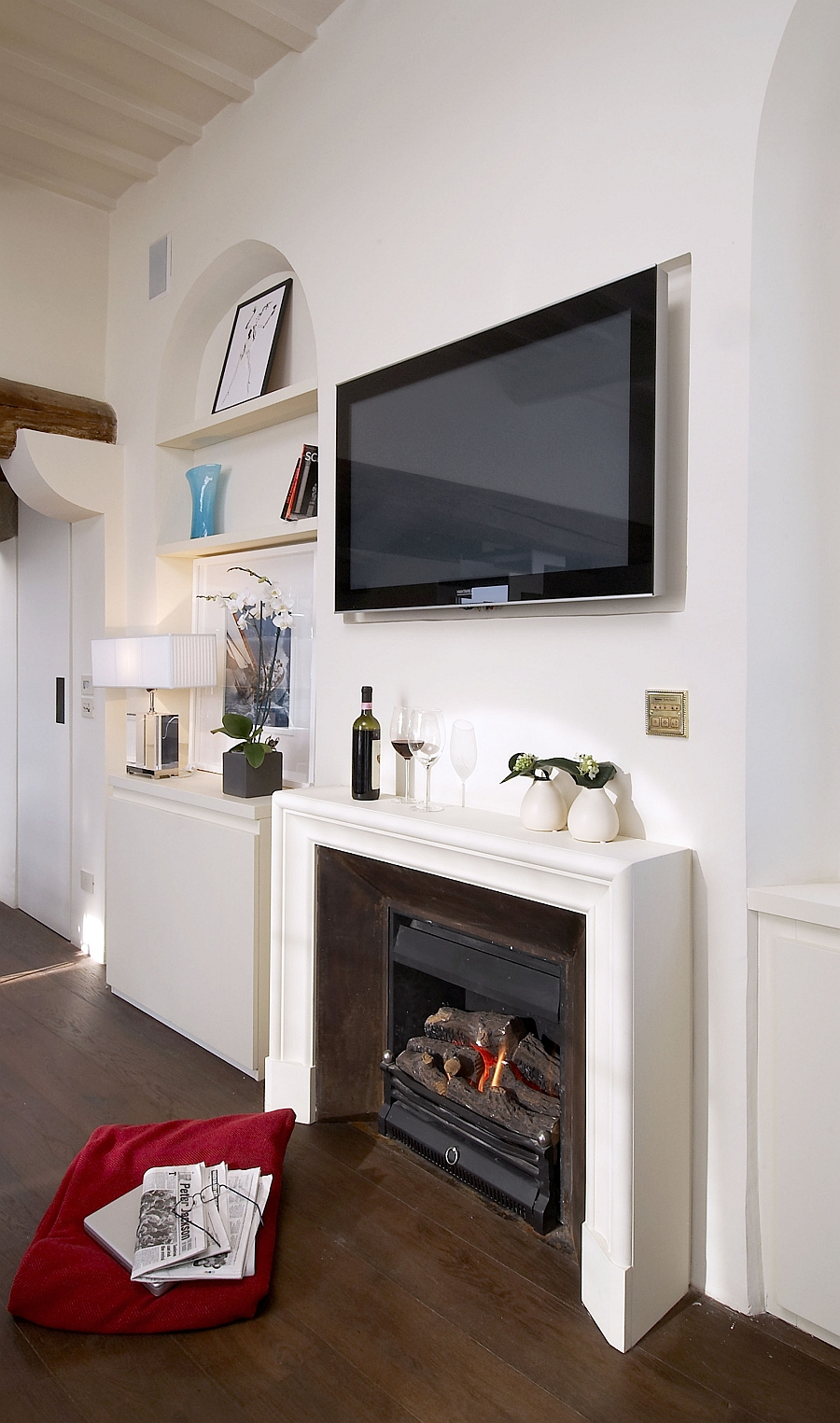 Wall-mounted television above the fireplace in the living room