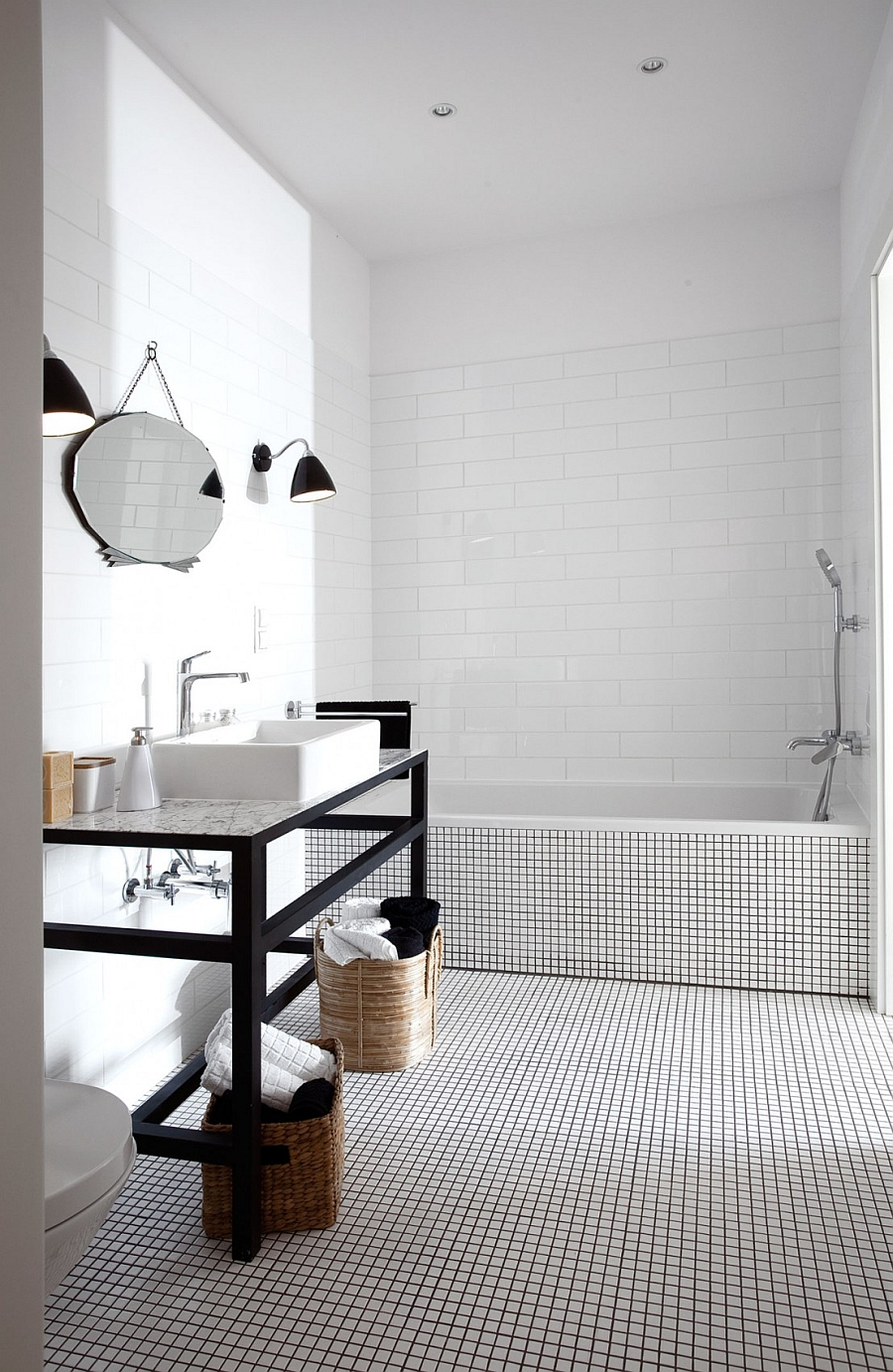 Wall sconce in the bathroom add drama even while saving up on space