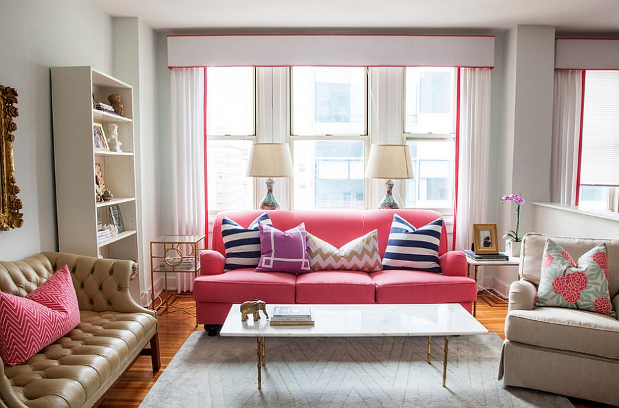 A touch of hot pink in the chic living room [Design: Caitlin Wilson]