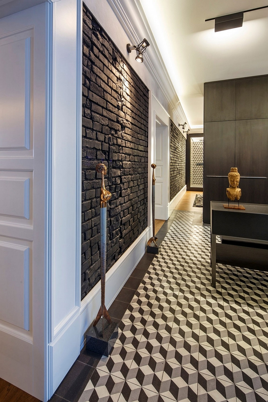 Accent lighting puts focus on the dark brick walls