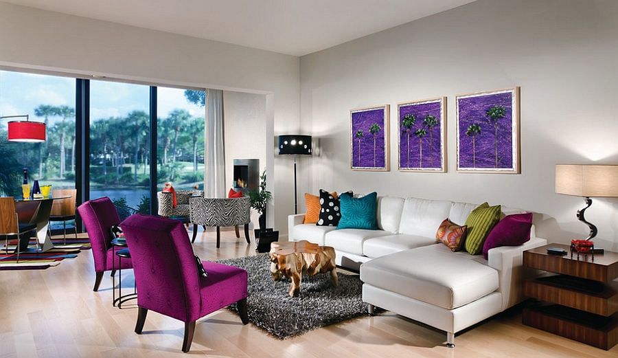 An array of accent colors brightens the posh living room [Design: Decorating Den Interiors]