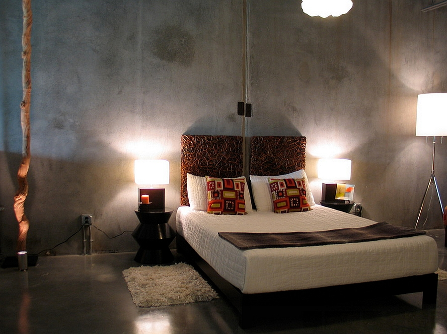 Basic concrete walls and floor look amazing in this industrial bedroom [By Pangaea Interior Design]