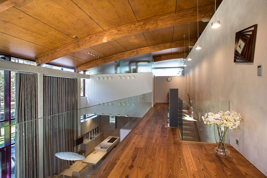 Beautiful mezzanine level of the private residence with glass railing