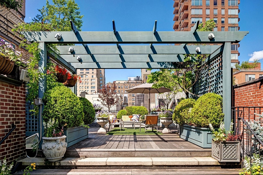 Beautiful rooftop garden with pergola of the Manhattan Apartment Inspired Manhattan Apartment Showcases Dashing Color And Flair Of Rio!