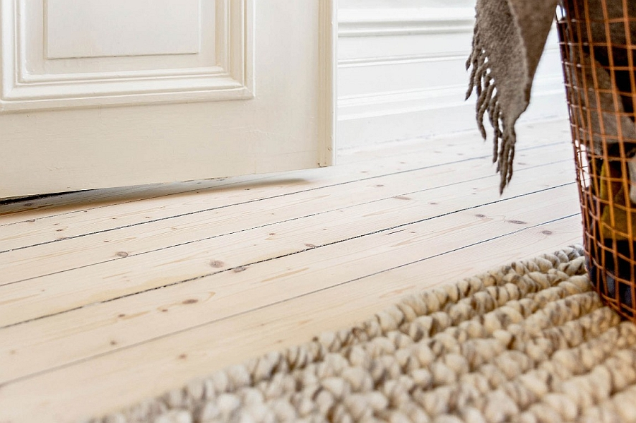 Beautiful wooden floor and carpet bring textural contrast to the space