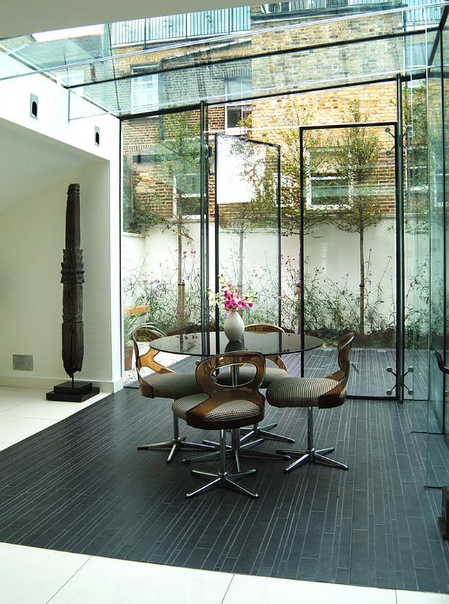 Black porcelain tile demarcates the lovely dining space