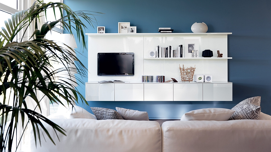 Blue accent wall adds to the allure of the wall unit and the TV Space